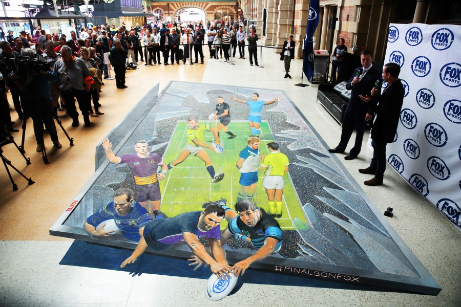 3d artwork of NRL players of footy ground smashing out of a television screen into the viewers loungeroom