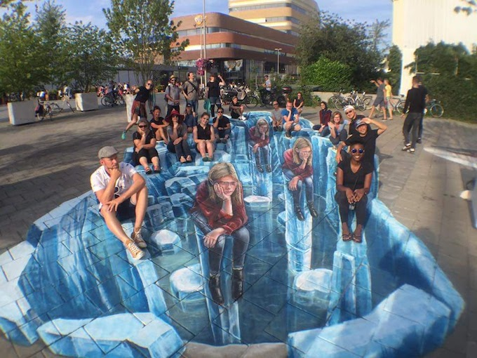 World Street Painting Festival artists and masterclass students pose in Leon Keers iceberg artwork.