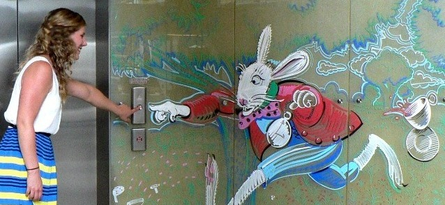 white rabbit racing for the elevator