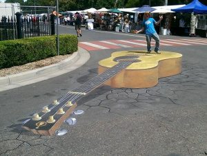 Giant 3D chalk art Golden Guitar in Tamworth by Rudy Kistler
