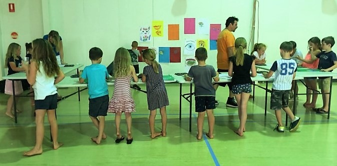 Kids participating in an art workshop