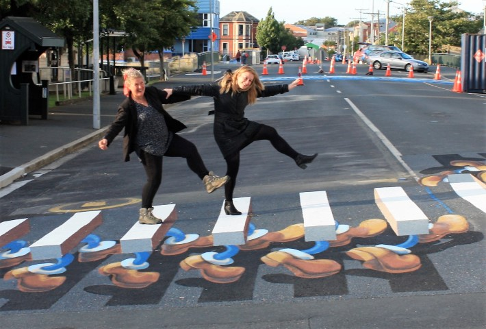 girls on 3d pedestrian crossing