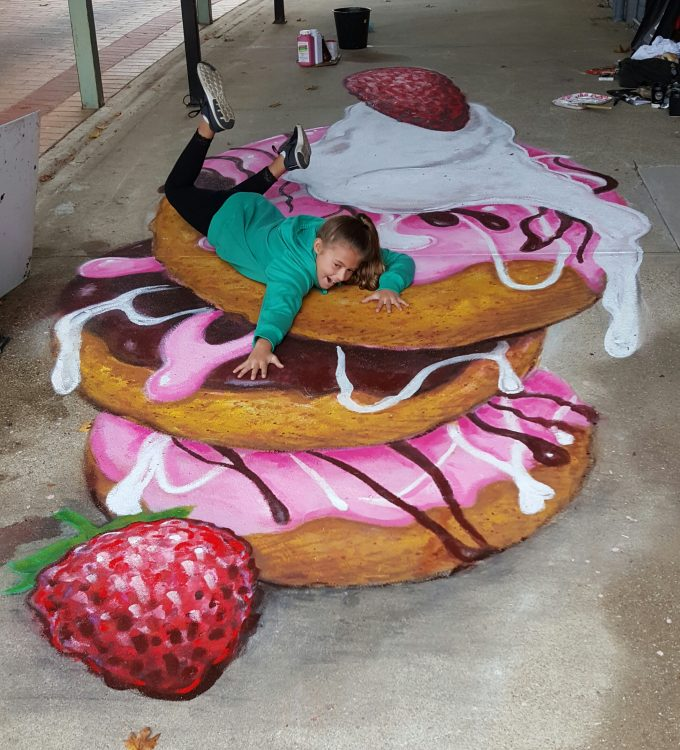 3d street art pink and chocolate donuts