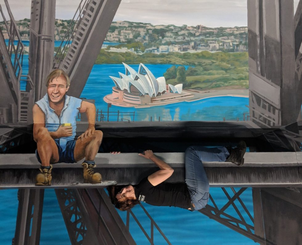 Andi Mether posing on Jenny McCrackens Harbour Bridge 3D illusion