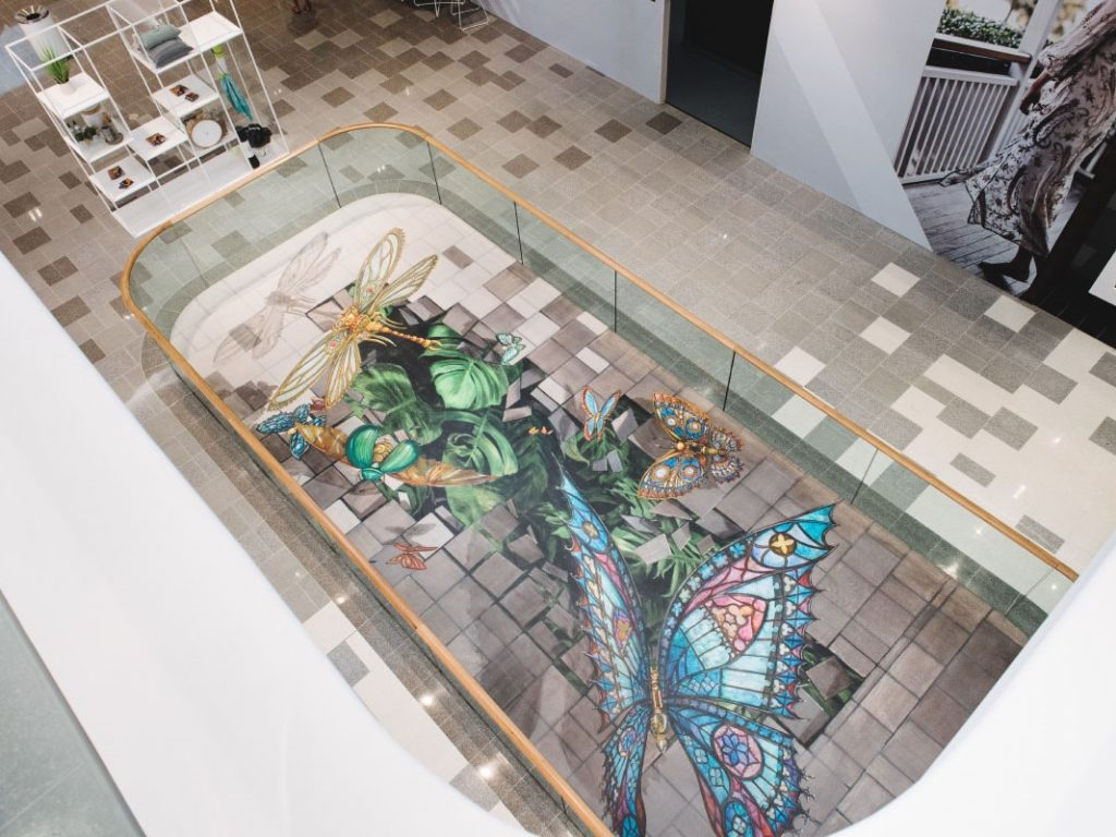 3d floor mural featuring of steampunk butterflies flying out of hole in the ground