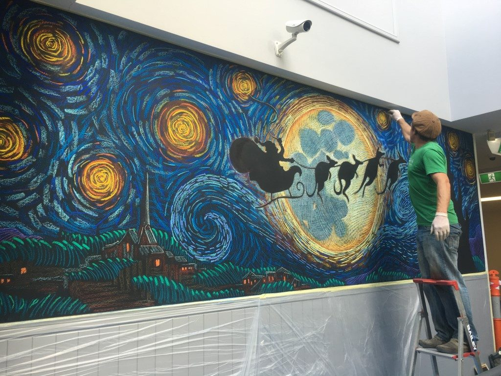 artist drawing Santa Van Gogh starry night scene