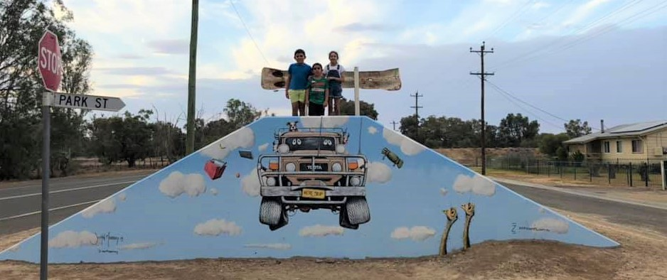 Bouncing 4wd mural on water levy in Brewarrina
