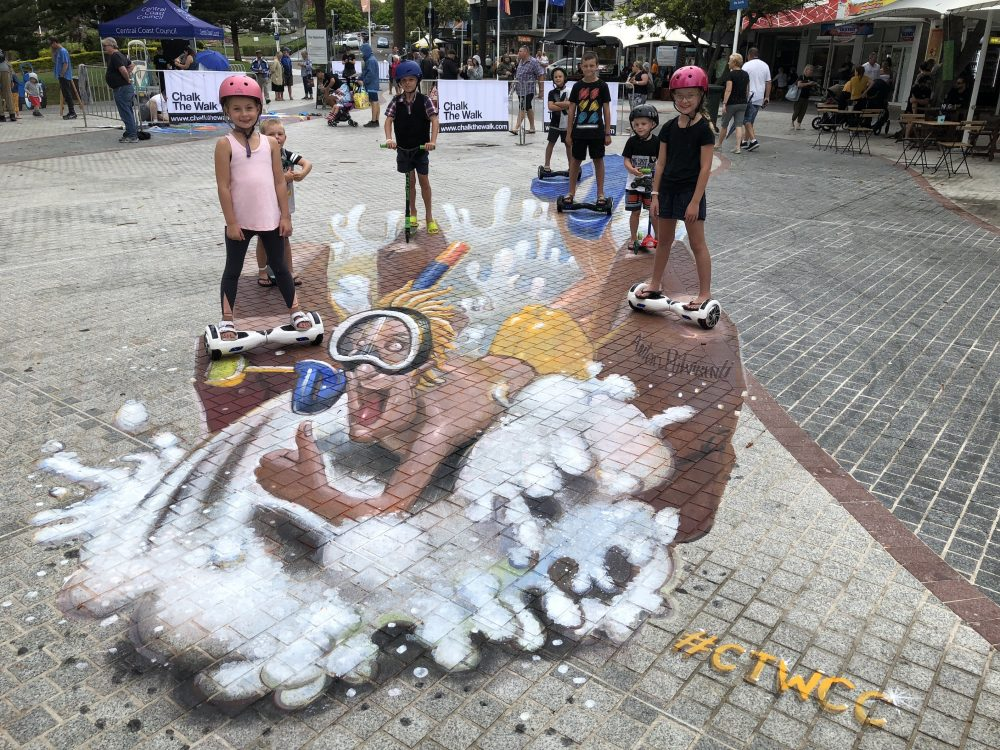 3d chalk artwork at CTW 2020 kids hoverboards pose